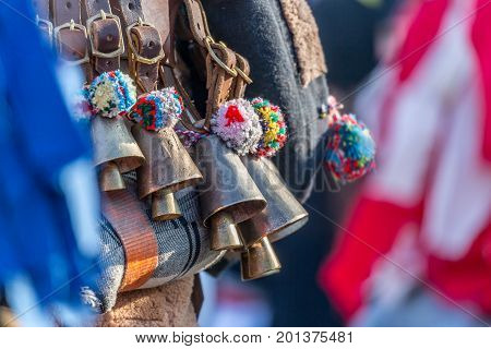 PERNIK, BULGARIA - JANUARY 27, 2017: Bells hanging on a bell are used for chasing away evil at Surva, the International Festival of the Masquerade Games