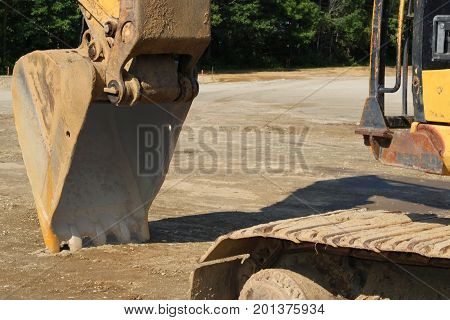 close-up view of a bulldozer bucket beginning to move the earth