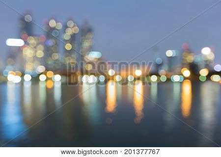 City blurred bokeh light night view waterfront abstract background