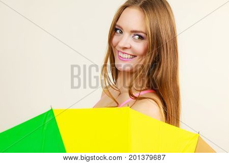 Shy Woman Hiding Behind Colorful Umbrella