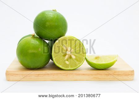 Fresh slide limes on wooden board fruit isolated