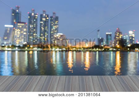 Opening wooden floor Twilight blurred bokeh city downtown waterfront abstract background