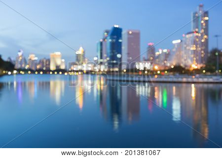 Reflection blurred bokeh light city downtown abstract background
