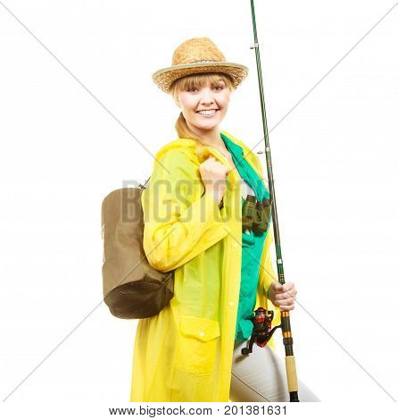 Fishery spinning equipment angling sport and activity concept. Woman wearing raincoat holding fishing rod ready for adventure.