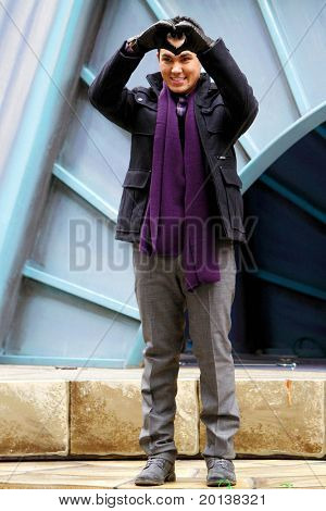 NEW YORK - NOVEMBER 25: Carlos Pena of Big Time Rush attends the 84th Macy's Thanksgiving Day Parade on November 25, 2010 in New York City.