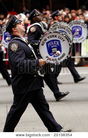 NEW YORK - NOVEMBER 25: Marching band drummers attends the 84th Macy's Thanksgiving Day Parade on November 25, 2010 in New York City.