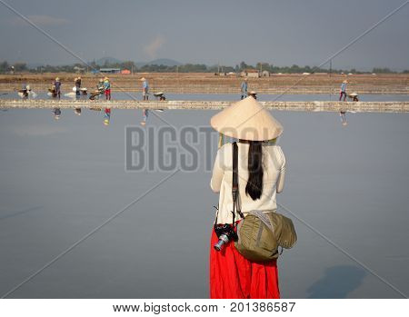 A Tourist Taking Pictures On The Salt Field In Vietnam