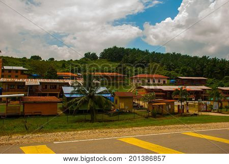 Traditional Village In Malaysia, Houses On Stilts, Borneo Island, Sabah.
