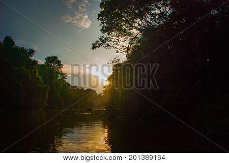 Kinabatangan River, Rainforest Of Borneo Island, Sunset. Sabah Malaysia