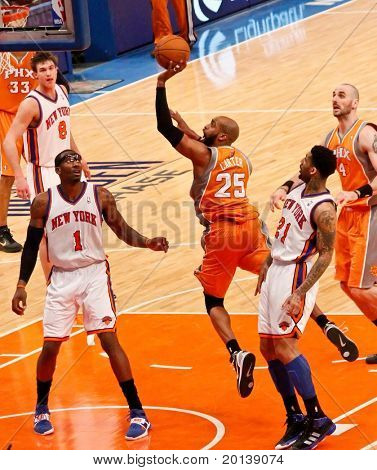 NEW YORK - JANUARY 17:  Phoenix Suns shooting guard Vince Carter (25) dunks the ball against the New York Knicks on January 17 at Madison Square Garden in New York City.