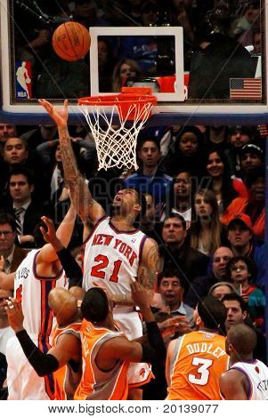 NEW YORK - JANUARY 17:  New York Knicks shooting forward Wilson Chandler (21) shoots a basket against the Phoenix Suns on January 17 at Madison Square Garden in New York City.
