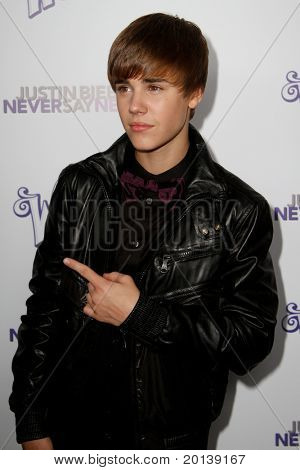 """NEW YORK, NY - FEBRUARY 02: Justin Bieber attends the """"Justin Bieber: Never Say Never"""" New York movie premiere at the Regal E-Walk 13 Theater on February 2, 2011 in New York City."""