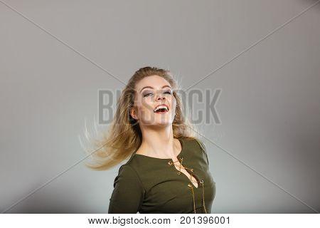Attractive Blonde Woman Wearing Tight Green Khaki Top