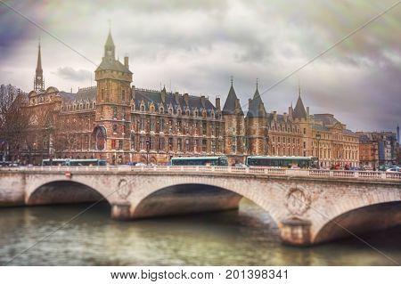 The Pont au Change is a bridge over the Seine River in Paris. France. (With tilt shift effect)