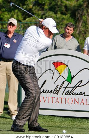 ORLANDO, FL - MARCH 23: Phil Mickelson tees off during a practice round at the Arnold Palmer Invitational Golf Tournament on March 23, 2011 at the Bay Hill Club and Lodge in Orlando, Florida.