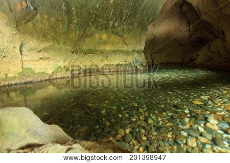 River coming out of cave with crystal clear water. Laos, near Nong Khiaw.