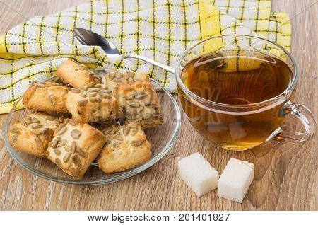 Tea, Lumpy Sugar, Plate With Cookies, Napkin And Teaspoon