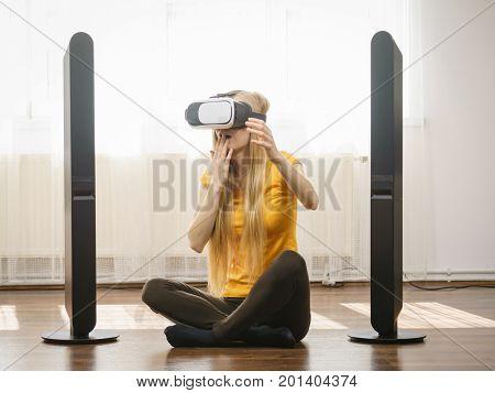 Girl Wearing Virtual Reality Goggles At Home