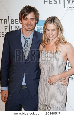 """NEW YORK - APRIL 22: Mira Sorvino and husband Christopher Backus attend the 2011 TriBeCa Film Festival premiere of """"Angel's Crest"""" at the BMCC TriBeCa PAC on April 22, 2011 in New York City."""