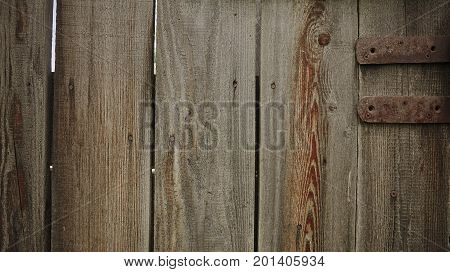 Wooden door with the old metal door hinge
