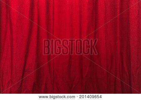 Wrinkled red curtain texture cloth material with wrinkles as background