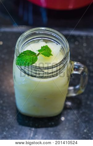 Glass Of Lemon Lime Blended Summer Drink With Mint Topping