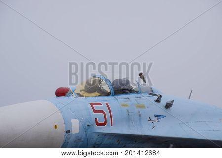 Su-35 Fighter At The Air Show. Aircraft On The Airfield To Show The Audience. The Nose Of The Plane