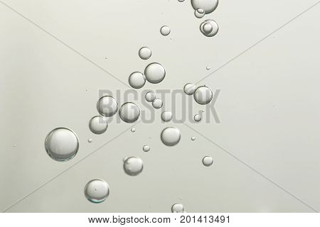 Flowing air bubbles over a blurred background