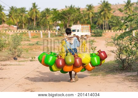 Indian Man Goes For Water, Puttaparthi, Andhra Pradesh, India. Copy Space For Text.