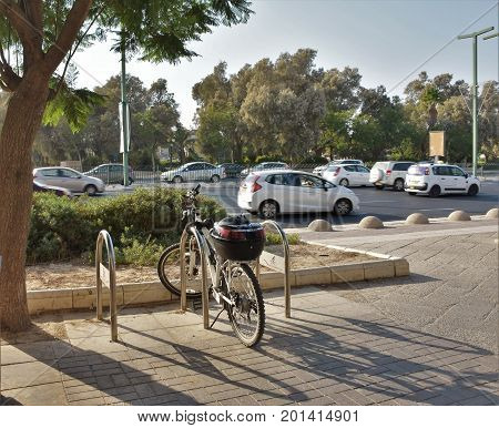 parked bicycle on the background of bussy road