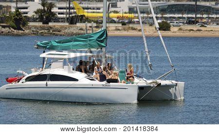 SAN DIEGO, CALIFORNIA, JUNE 9: San Diego Bay on June 9, 2017, in San Diego, California. A Bachelorette Party Aboard the Tigress Fun Cat Catamaran in San Diego Bay in San Diego.