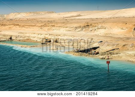 Finishing of remaining construction works on the new expansion channel of the Suez Canal opened in August 2015