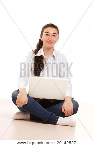 A college girl sitting on the floor
