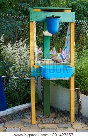 Home made washstand in the yard of the country house in Russia
