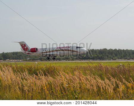 Nizhny Novgorod, Russia - August 23, 2017: CRJ100 airliner is landing on the runway of the airport Strigino.