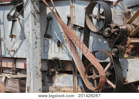 A belt powered threshing machine used in agricultural