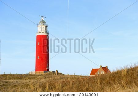Red lighthouse in the dunes from Texel