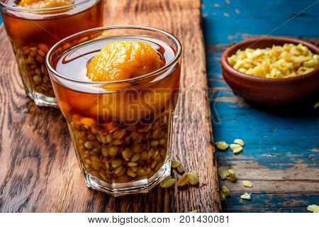 Mote Con Huesillo. Traditional Chilean Drink Made From Cooked Husked Wheat And Dried Peach On Wooden