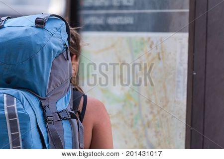 Gilr Traveler Alone See The Big City Map. Female Backpacker