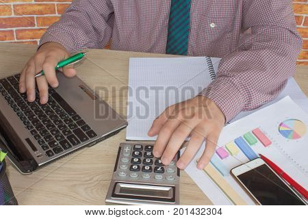 business accounting concept businesswoman and laptop with calculator on table working area. Man doing his accounting financial adviser working