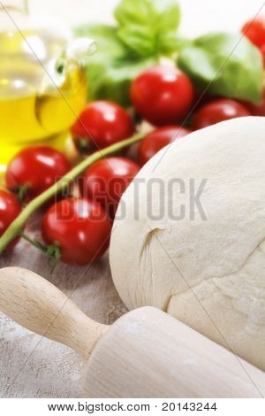 ingredients for homemade pizza(dough, cheese, olive oil and vegetables)
