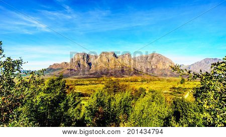 Hottentot-Holland Mountains surrounded by vineyards and farmland in the wine region of Stellenbosch in the Western Cape of South Africa