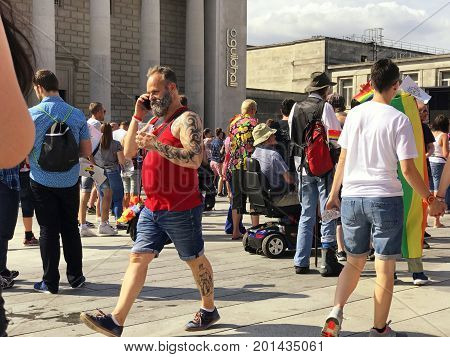 SOUTHAMPTON UK - August 26 2017: Southampton Pride 2017 City's second annual Pride event in Southampton UK. Man with beard on phone.