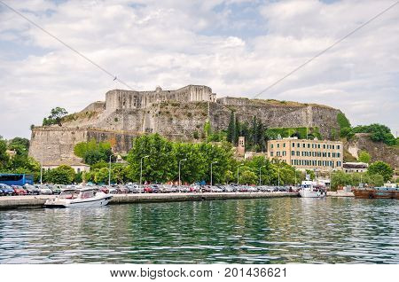 Corfu Greece - June 7 2017: View of the new citadel or Neo Frourio - a huge complex of fortifications dominating the northeastern part of the city of Corfu as seen from the sea.