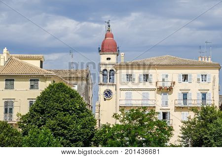 Corfu Greece - June 7 2017: The bell tower of the Saint Spyridon Church and apartments stores with balconies in the old city of Corfu.