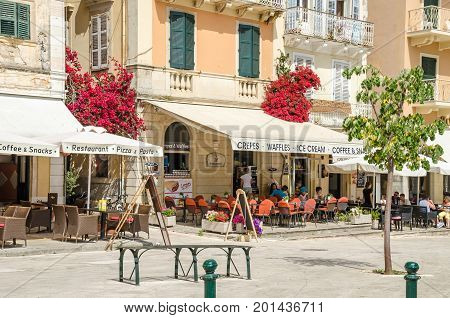 Corfu Greece - June 7 2017: The Liston in Corfu with its fashionable cafes a crowded relaxed place to sit and snack and watch the promenaders along the Spianada.