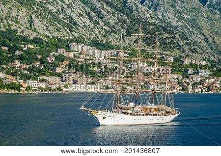 Kotor Montenegro - June 8 2017: A four-masted sailing vessel (sailing cruise liner) Sea Cloud moving into the port of Kotor.