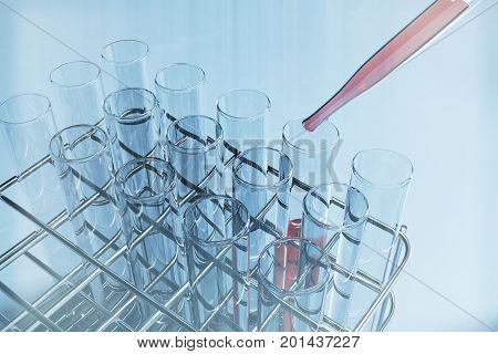 Lab retorts on tray. Medical background. 3D Rendering