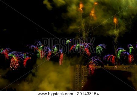 Scene from Fireworks Competition. Explosive pyrotechnic devices for aesthetic and entertainment purposes, art. Colorful fireworks at the city park. Numerous multicolored fireworks, salutes, small but unusual shapes