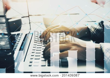 Side view and close up of woman hands using laptop with reflections on screen placed on desk with coffee cup and digital business grpah. Report concept. Double exposure